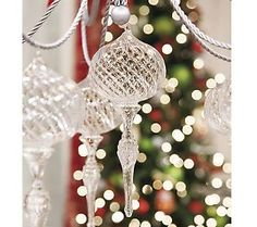 I love the shape of these ornaments. They add that visual interest to a tree, and the glass makes them go with anything.