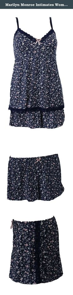 Marilyn Monroe Intimates Women's Pajama Short Set, Blue Pink Floral,X-Large. Marilyn Monroe intimates women's pajama cami and short set in a cute blue and pink floral pattern with navy lace trim. This adorable cami and short pj set is soft and comfortable with adjustable straps and feminie lace trim. Sure, you could wear an old t-shirt to bed, but why would you if you could wear this? Marilyn Monroe was a icon of style and sensuality. Now you can be too. The set is 94% polyester and 6%...