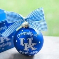 """With sophisticated style, the University of Kentucky Logo Ornament showcases school pride. Adorned with UK colors and the Interlock """"UK"""" logo, it's sure to be a fan favorite! Each ornament is perfectly packaged with a matching gift box and coordinating tied ribbon for easy gift giving and safe storage."""