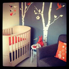 baby room - love how it's neutral but still has a pop of color, with birch trees and bright birds