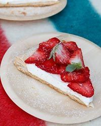 Strawberry Tart with Flaky Pastry- Elisabeth Prueitt invented this exceptional, flaky dessert, made with a rough puff pastry, for San Francisco's Tartine Bakery. She cuts the pastry into a precise circle and weighs it down during baking to create an elegant base for sliced strawberries and whipped cream. The adaptable crust can be topped with almost any seasonal fruit.