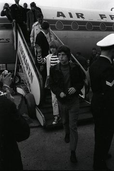 Mick Jagger and Brian Jones of of The Rolling Stones get off an Air France plane at the airport on September 13th 1965 in Hamburg Germany