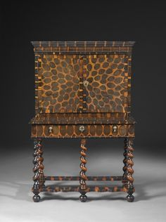 A Charles II very rare William and Mary oyster veneered cocus wood cabinet on stand, circa 1670.
