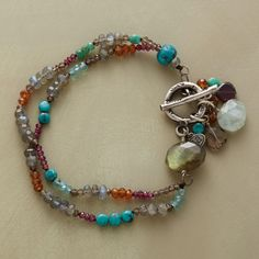 """FINALE BRACELET -- A throng of gems gathers at the sterling silver toggle clasp, a fitting finale to two colorful strands of turquoise, labradorite, hessonite garnet, rhodalite garnet, smoky quartz, apatite and aquamarine. A handcrafted exclusive. 7-1/2""""L."""