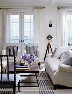 Crisp linen and fresh white drapes and walls.