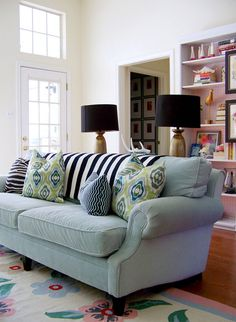 love the mix of patterns and color, makes me less afraid to try it + love the black and gold lamps.