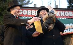 """The handlers of Pennsylvania's most famous groundhog, Punxsutawney Phil, said the furry rodent failed to see his shadow at dawn Tuesday, meaning he """"predicted"""" an early spring."""