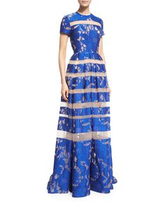 Elie Saab floral embroidered gown with sheer stripes. Jewel neckline. Short sleeves. Fitted bodice; pleated full skirt. Seam across the natural waist. Hem falls to floor. Train at back. Exposed back z