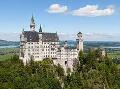 "Neuschwanstein Castle -  ""New Swanstone Castle""[ - is a nineteenth-century Romanesque Revival palace on a rugged hill above the village of Hohenschwangau near Füssen in southwest Bavaria."