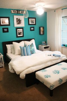 Turquoise accent wall complimented with white bedding for a crisp clean look. ^nn