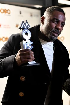 Idris Elba Photos - Idris Elba poses in the winners room with the Paving The Way award at the MOBO Awards at First Direct Arena Leeds on November 29, 2017 in Leeds, England. - MOBO Awards - Winners Room