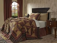 From the Lasting Impressions Collection by VHC Brands...  Kendrick Quilt... is a lovely traditional courthouse steps pattern patched in colors of gold, chocolate brown and dark red and contrasting plaids... It is 100% Cotton and features stitch in the ditch construction.