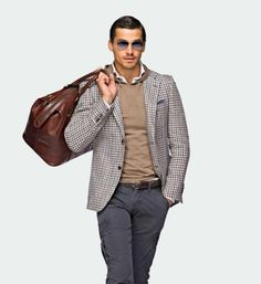http://chicerman.com  suitsupply:  Editors Pick:  Linen Italia Sport Coat $299  You have your basics taken care of but as spring approaches you are in search of a unique sport coat for your wardrobe with a more casual feel. Something half canvassed with soft-shoulder construction perhaps? Well this ones for you. This blue and brown check linen jacket pairs perfect with a pair of slim navy cargos as shown above as it does with chinos and jeans. And you thought we were just known for our suits…