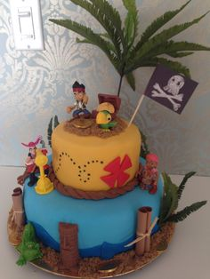 "Jake and the Neverland Pirates Cake - 2 layered 10"" base, 2 layered 6"" top, Wilton Ready to Use Fondant, Walmart Figurines, Artificial Fern as Palm tree. Brown sugar sand, chocolate dollars, Happy Birthday scrolls"