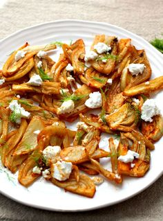 Indian Spiced Rosted Fennel and Goat Cheese Salad. Amazing what a drizzle of  xtra virgin olive oil, a sprinkling of ground cumin, coriander, garlic and a touch of mild chilli or paprika does to roasted fennel along with some fresh goat cheese, YUM!