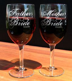 These custom engraved wine glasses are perfect for toasting to the new Bride and Groom and will be a nice token of the wedding day. This listing is for two glasses.   They can refer to any relation to the Bride and Groom and are marked with the date of the special day.    For example they can say any of the following:    Mother of the Bride  Father of The Bride  Stepmother of the Bride  Stepfather of the Bride  Sister of the Groom  Brother of the Bride  Aunt of the Bride  Uncle of the Groom…