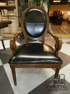 Bernard's oval back arm chair in black. Measures 23*26*42. Two in store at time of posting.