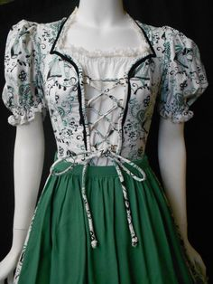 Vintage Authentic Dirndl German Full Skirt Lace Up Front Apron Circle Swing Dress. $85.00, via Etsy.