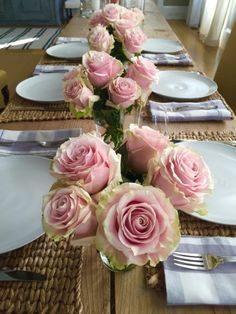 An easy tip for stylish centerpieces - choose one flower and use lots of them!  And one more thing - instead of finding lots of matching vases for my flowers, I just use water glasses!  Simple and elegant - my favorite combination.