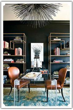 black wall, gold bookshelves --statement desk