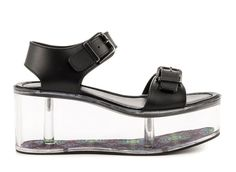 You'll be on cloud nine in the Qloud Athena. This spunky style from YRU features a black synthetic upper with two adjusting buckles.  A clear 3 inch wedge and 2 inch platform is highlighted by a multi color printed fabric inside. http://zocko.it/LDCBn