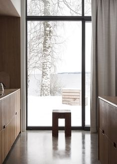 A modern and minimal cluster house created by Norm Architects , The Gjøvik House is located on a majestic hill side north of Oslo, facing...