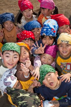 Japanese kids playfully crowd together for photo. - Love how they're all wearing colorful scarves - both girls & boys.