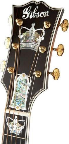 "Gibson J-250 Monarch Acoustic Guitar | Antique Natural....ebony moustache bridge with abalone inlays, genuine diamond gem ""I"" Gibson logo setting, and gold tuners. This is absolutely gorgeous."