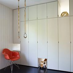 Cool built-in storage in a playroom - love the rings!