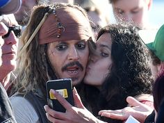 Johnny Depp (L) dressed in his costume as Captain Jack Sparrow meets fans following filming in Brisbane, Australia on June 4, 2015. Depp is starring in the 5th installment of the Pirates of the Caribbean movie currently being filmed in Queensland, Australia. 'Pirates of the Caribbean: Dead Men Tell No Tales' will be released in 2017.  Dave Hunt, EPA