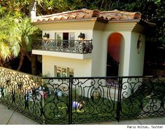 McMansion, it will only set you back $325,000!A brand new level excess that perhaps can only be reached by Paris Hilton. See, Hilton built this two-story, air-conditioned, designer furniture-decorated, heated, and black crystal chandelier-boasting miniature mansion for her dogs. Yes, Paris Hilton's dogs live in a more expensive, decadent, and consumptive house than millions of Americans do. More pics after the jump.