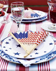 Trim a fence with paper flags. Put flag-inspired fans on the table to encourage conversation as well as provide the occasional breeze.