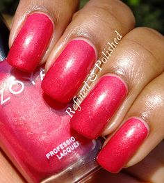 Zoya nail polish in color Kimber, a hot coral pink with a golden shimmer