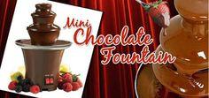 Συσκευή Συντριβάνι για Fondue Σοκολάτας, Mini Fondue Chocolate Fountain, το απόλυτο gadget για τους λάτρεις της σοκολάτας! Η σοκολάτα ξεκινάει την διαδρομή της από την βάση της συσκευής και καταλήγει να αναβλύζει από το μίνι σιντριβάνι, δημιουργώντας ένα απολαυστικό θέαμα που θα γίνει η ατραξιόν σε κάθε τραπέζι και πάρτι. Αφήστε μικρούς και μεγάλους να επικαλύψουν με σοκολάτα μικρές λιχουδιές όπως μπισκότα, ζαχαρωτά, φράουλες κ.α και να είστε σίγουροι πως θα το ευχαριστηθούν. Από… Mini Chocolate Fountain, Chocolate Fountains