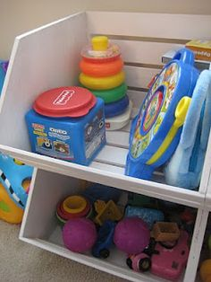 DIY toy storage bings made from vegetable crates that evidently used to be sold at Michael's. Can't find them online. Maybe they are still in stores?