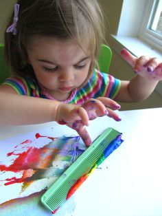 rainbow painting project for kids using a comb