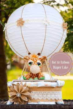 Lift your baby shower to the next level with this easy DIY Gender Neutral Hot air Balloon Diaper Cake tutorial! It will be the perfect center piece decoration to take your party Up up and away! Create more than one for fun party favors for Expectant Moms or for baby's first birthday gifts.