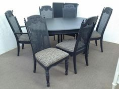 $289 - Extra large table 6 chairs two leaves painted black and distressed with new animal print upholstered seats. ***** In Booth D17 at Main Street Antique Mall 7260 E Main St (east of Power RD on MAIN STREET) Mesa Az 85207 **** Open 7 days a week 10:00AM-5:30PM **** Call for more information 480 924 1122 **** We Accept cash, debit, VISA, Mastercard, Discover or American Express