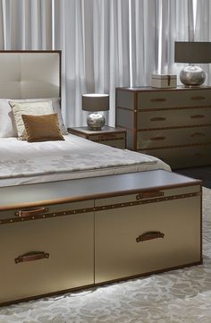 The bedroom won't be boring with Orient express bedside tables and Amboseli bed by Heritage Collection for Luxury Living Group