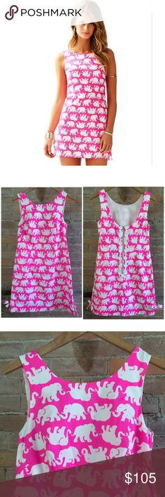 Lilly Pulitzer Tusk In Sun Delia Dress Adorable hot pop pink Delia dress from Lilly Pulitzer in Tusk In Sun elephant print. Hard to find! Exposed zipper and bows at hem. A little smudge on a few of the white medallions, otherwise like new. Lightweight lined cotton. Size 0. Lilly Pulitzer Dresses Mini