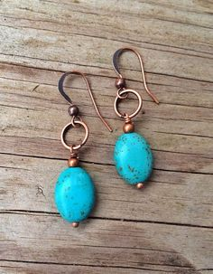 Beautiful deep blue turquoise hanging from a copper ring. Approx 1 in length. To view more of my handmade jewelry, please visit: