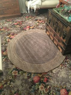 Our beautiful greige rug that breaks up the floral rose carpet beautifully. totally finishes off our bedroom I love it! It mimics the circular cushions on the bed and chaise lounge. Love my great great grandmothers trunk just sitting on the edge of the rug but at the end of our bed.