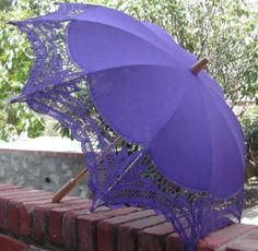 had an idea: a pretty purple parasol hanging upside down above a table. maybe gift table?