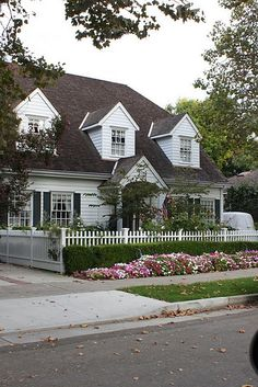 Love this triple  cape cottage. This reminds me of the house used in Father of the Bride.