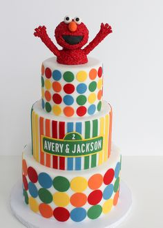 A bright 3-tier Elmo cake for Sesame Street fans #villagecakecraft