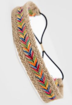 Super cute headband featuring a rainbow chevron design with a black elastic…