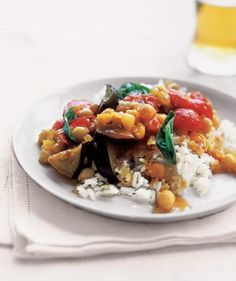 Curried Eggplant With Tomatoes and Basil | Eating an exclusively plant-based diet can be incredibly satisfying and tasty—especially with these hearty recipes.