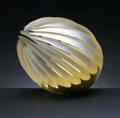 Dale Chihuly. Looks like a seed. Awesome.