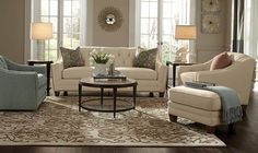 A soft palette of taupes and grays sets a calm mood this year and provides a background for accent colors like refreshing blues and greens. Over-sized interpretations of paisley or ikat patterns are popular (as in the sofa pillows and rug above) and touches of gold in accessories have made a comeback.  Notice the coordinating, but not matching, end tables and lamps. This handsome furniture grouping is by Flexsteel.