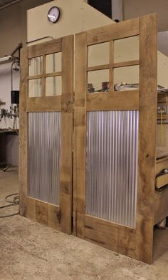 MADE TO ORDER Rustic Barn Door - Sliding Barn Door w/Barn Tin #9376  Dimensions 36 Wide x 85 H (3/4 to 1-1/2 thickness)  Window: Lexan - Clear Polycarbonate ****CUSTOM SIZES AVAILABLE*****   **The price stated is for the exact dimensions listed above. EACH ITEM IS CUSTOM BUILT AND CAN BE FULLY CUSTOMIZED TO YOUR TASTE OR STYLE . Any changes will affect both the price and the shipping. Please contact us for any changes or shipping questions.    Materials: Reclaimed Rustic Barn Wood & Metal…